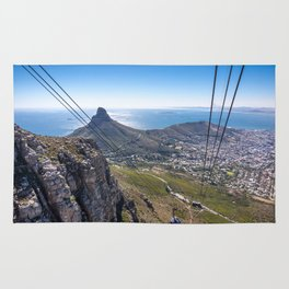 Cable car going up Table Mountain in Cape Town, South Africa Rug
