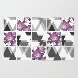 Pink lilies on grey triangles . Rug