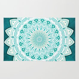 White Mandala on Blue Green Distressed Background with Detail and Textured Rug