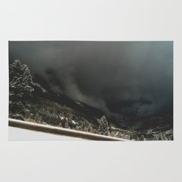 ominous snow storm in the valley Rug