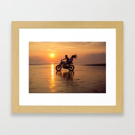 Young couple posing in the beach on custom vintage motorcycle Framed Art Print