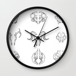 Cracking skulls Wall Clock