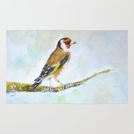 European goldfinch on tree branch Rug