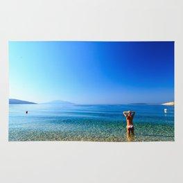 Girl at the sea in Croatia Rug