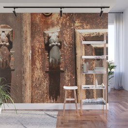 Antique wooden door with hand knockers Wall Mural