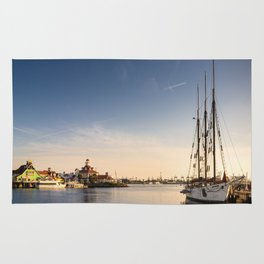 Sailboat moored in Rainbow Harbor, Long Beach - CA Rug