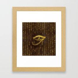 Golden Egyptian Eye of Horus  and hieroglyphics on wood Framed Art Print