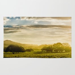 Sunrise over the farm Rug