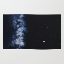 Contrail moon on a night sky Rug