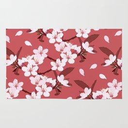 Sakura on red background Rug