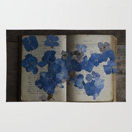 hydrangea and book Rug