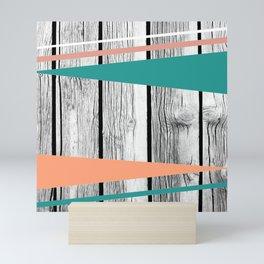 Colored arrows on wood Mini Art Print