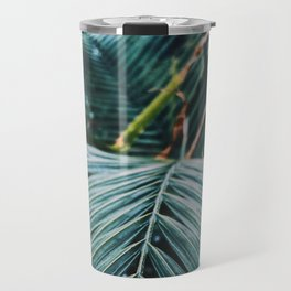 Palm leaves in a cold place Travel Mug