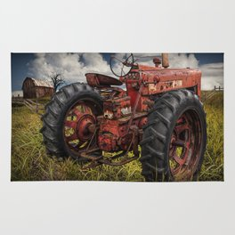 Abandoned Old Farmall Tractor in a Grassy Field on a Farm Rug