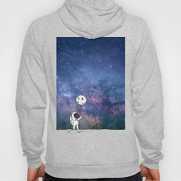 Cute Astronaut holding moon balloon with craters and stars cosmos background Hoody