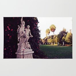 Statues dancing at Huntington Park Rug