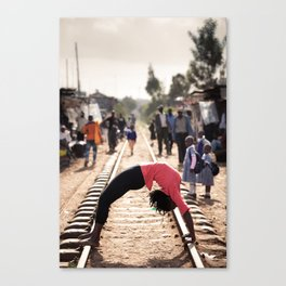 Africa Yoga Project. Irene in wheel on Kibera train tracks, Nairobi Kenya Canvas Print