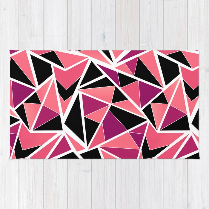 abstract geometric pattern in black pink triangles rug by