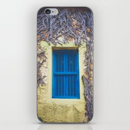 blue shutter window in yellow building with creeping vines iPhone Skin