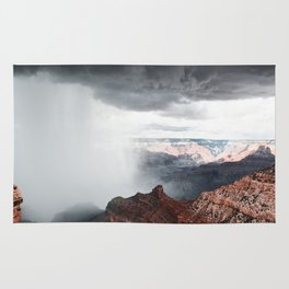 a storm in the grand canyon Rug