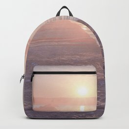 Pink pastel sunset on the break water Backpack
