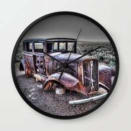 Rusting in the desert Wall Clock