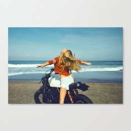 Young girl on motorcycle Canvas Print