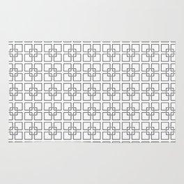 Black Interlocking Geometric Square Pattern on White Rug