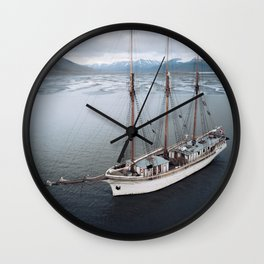 Sailing Ship in front of a Mountain Valley in Norway Wall Clock