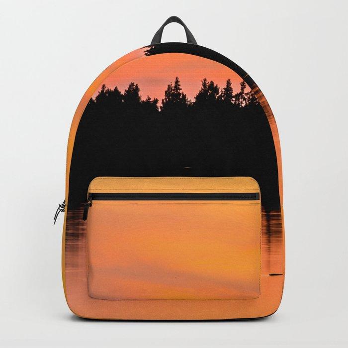 Orange Sunset With Forest Reflection On Lake Backpack