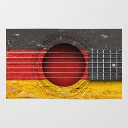 Old Vintage Acoustic Guitar with German Flag Rug