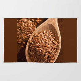 Brown linseeds portion on wooden spoon Rug