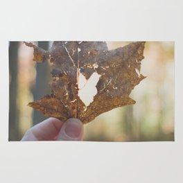 Heart inside dying leaf Rug