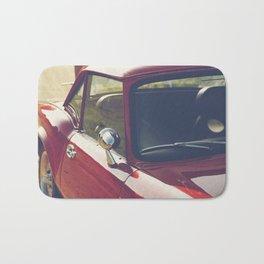 Sportscar, supercar, windscreen details, red triumph spitfire, english car Bath Mat