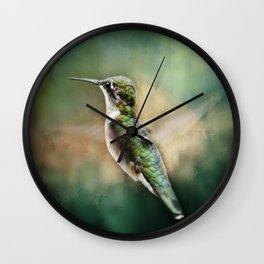 Single Humming bird in flight Wall Clock