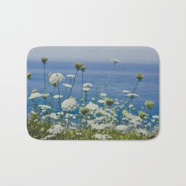 Flowers by the Beautiful Blue Sea Bath Mat