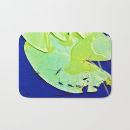 Water striders on lily pad Bath Mat