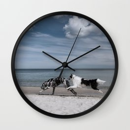 Running dogs at the beach Wall Clock