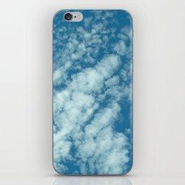 Fluffy clouds in a blue sky iPhone Skin