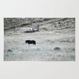 Horse in high desert grass Rug