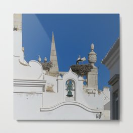 storks build nests on the church in the old town of faro, portugal, europe Metal Print