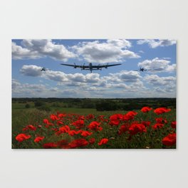 Lancaster Spitfire and Hurricane over poppy field Canvas Print