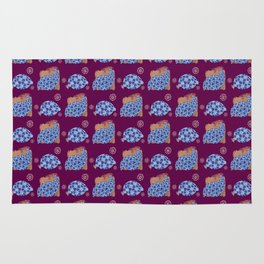 blue birds pattern on gold and purple Rug