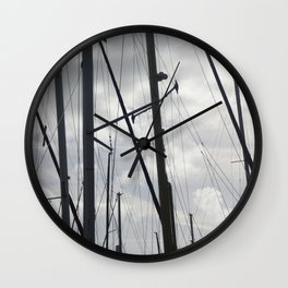 Yacht masts on cloudy sky Wall Clock