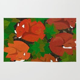 Sleepy foxes and Grapevine leaves Rug