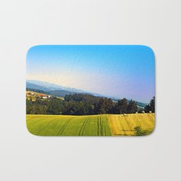 Tipping the scenery Bath Mat