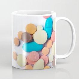 Numerous colorful pills on white background. Coffee Mug