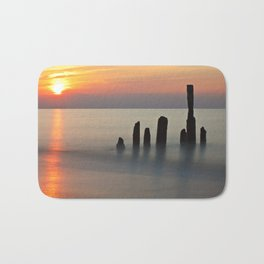 Groyne and sunset on the Baltic Sea coast Bath Mat