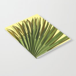 Palm on Yellow Notebook