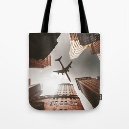 airplane in manhattan Tote Bag